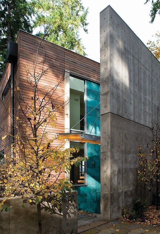 The pop of color from the copper cladding combined with the wood and concrete materials is fantastic. Dorsey Residence by Coates Design Architects | Home Adore