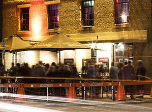 Customers enjoying a drink and chat at Knoppies at night