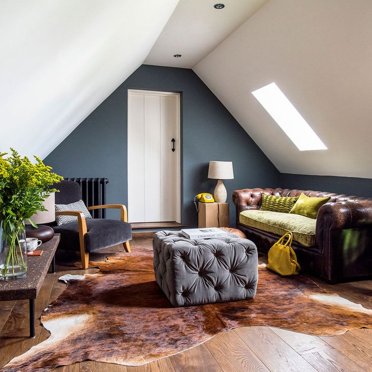 Tent-like attic living room with sloped ceilings on both sides