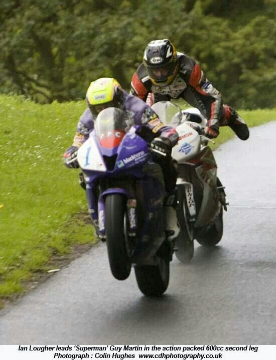 Ian Lougher and Superman Guy Martin. Apparently he has his helmet specially made to fit his sideburns.