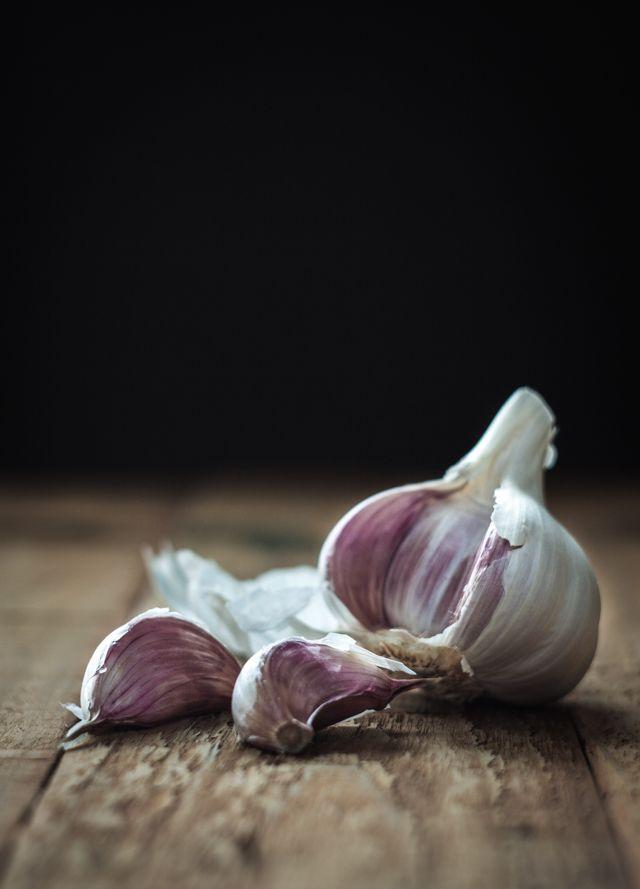 Garlic on wooden table - by Miroslav Jesensky