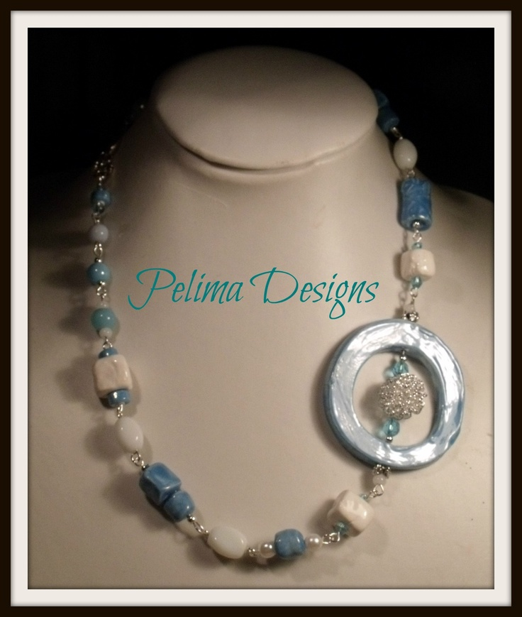 Soft blue and white necklace made with my own handmade clay beads and finished with glass beads and crystals.