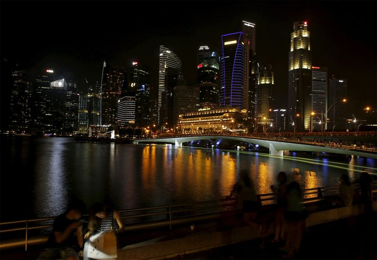 The skyline of the Central Business District before and (click or tap to view) after lights were turned off during Earth Hour in Singapore on March 19, 2016. <strong>[<em>Click or tap the image to view transition</em>.]</strong>