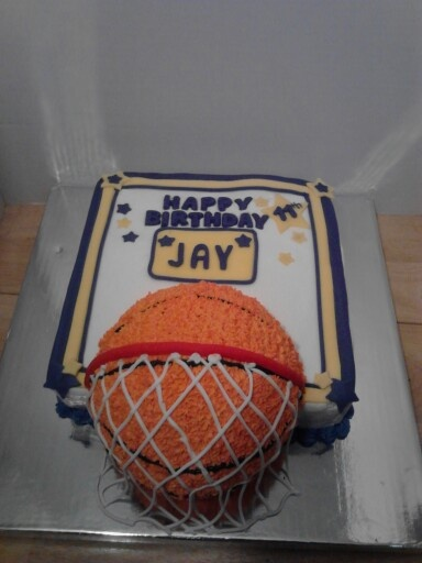 3D Basketball Birthday Cake made with a 9 inch square pan & wilton ball pan. Buttercream icing ...