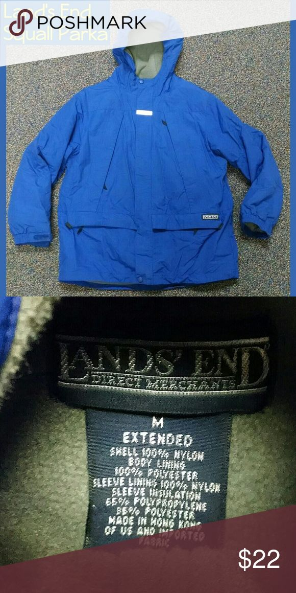 Lands End Squall Parka Winter Coat Great condition!    This is a size Medium Extended.  What does that mean?  It means that it has a few extra inches around the torso to accommodate extra range of movement, bulky underlayers, or a husky body. :-).  It is the same length as the non-extended sizing.  Bright blue with grey interior.  Bundle to save $$! Lands' End Jackets & Coats