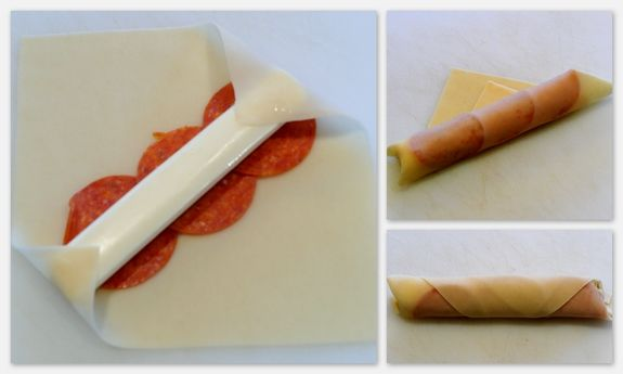 Mozzarella-Pepperoni Sticks ~ Made Easy Serves 6 -  12 pieces of string cheese, 12 egg roll wrappers, 36 slices of pepperoni, Oil for deep-frying, Marinara or pizza sauce
