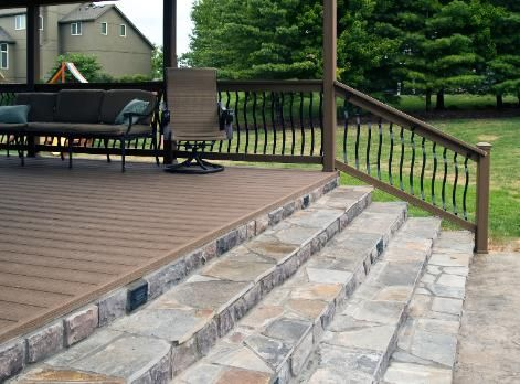 Cedar Shake Shingled Covered EverGrain   Weathered Wood Deck With Baroque  Balusters, Flagstone Steps, Stone Veneered Skirting, Stamped/stain.