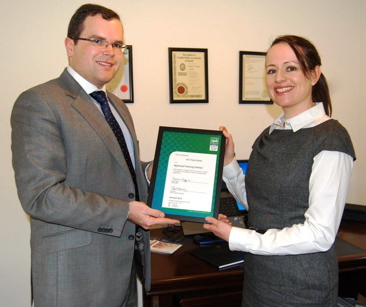 Angela Garvey from AG Associates is pictured here receiving the AEP Certificate from Cathal McNamara from the CPA Institute.