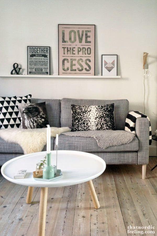 decoracion-salon-decoracion-pared-sofa-decorar-con-laminas-estantes-cuadros