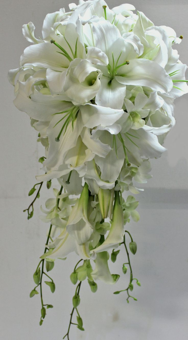 Best 25 lily bouquet ideas on pinterest white lily bouquet stylish trailian wedding bouquet of white oriental lilies singapore orchids and calla lilies dhlflorist Choice Image