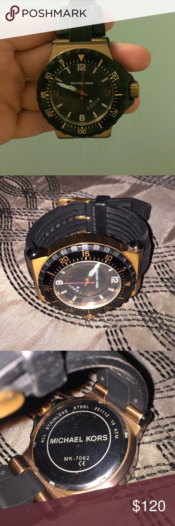 Men's Michael kors watch black and copper A big face watch with black and copper details and a black rubber strap. Great condition very small scratch on glass. Comes with original box- battery works fine. Michael Kors Accessories Watches