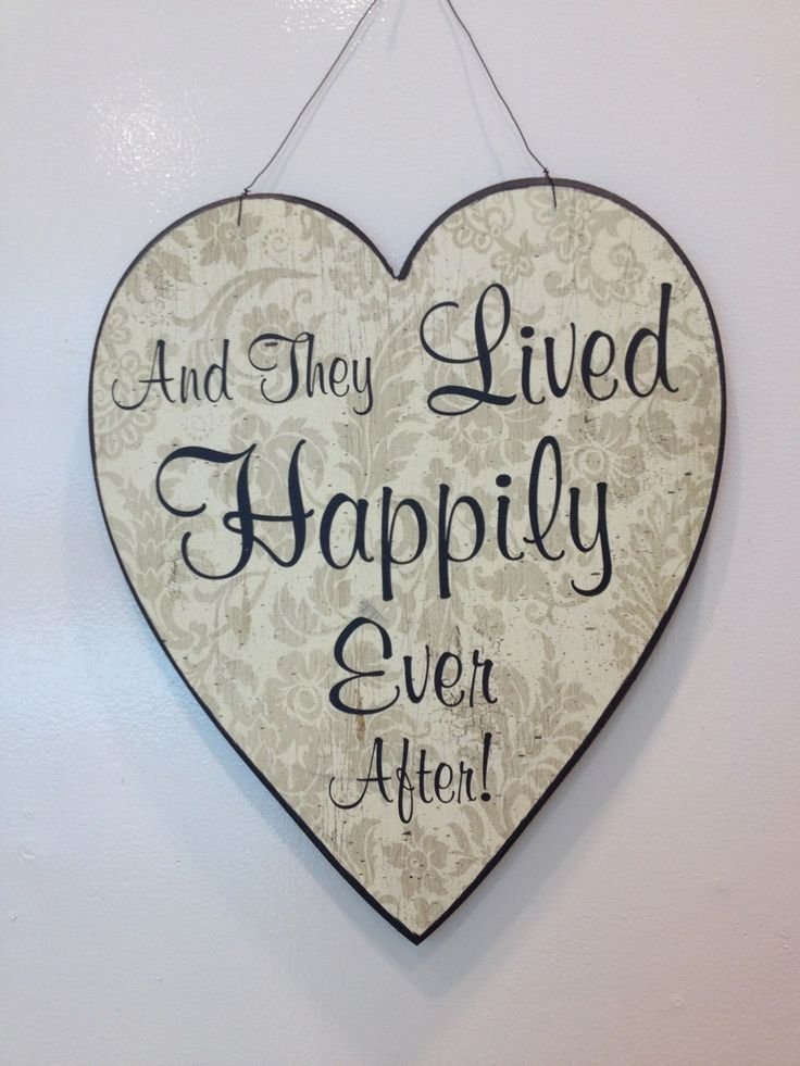 And they lived happily ever after Heart Sign £15.99 Beautiful 'And they lived happily ever after' heart sign. Black and cream wooden sign with floral detail hangs by attached wire, will make a lovely gift for newlyweds: Approx Dimensions: H: 36cm x W: 30.3cm x D: 1.3cm