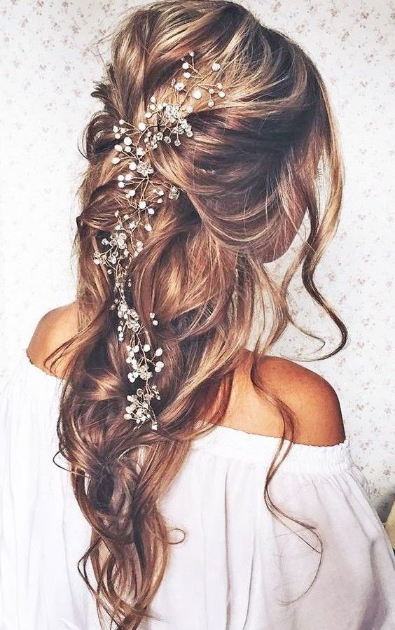 Long hair with flower detailing radiates effortless elegance, elevating your wedding day ensemble.