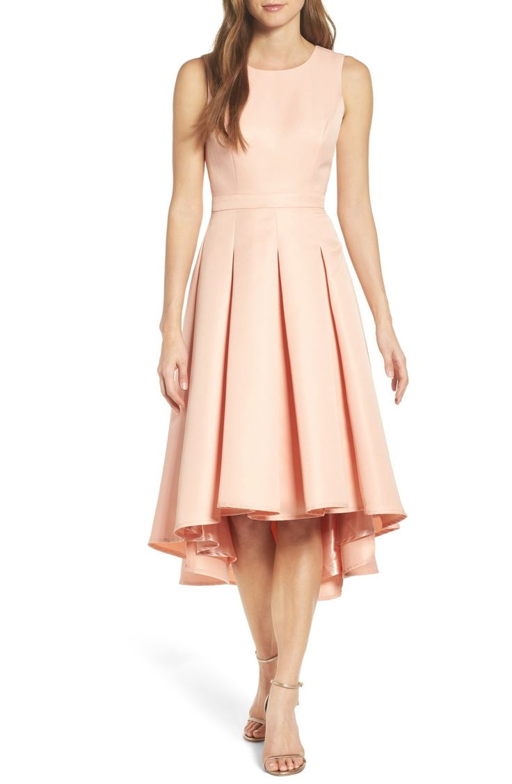 Free shipping and returns on Lulus Cutout Back Tea Length High/Low Dress at Nordstrom.com. A lustrous party dress with ladylike charm spins around to a flirty cutout in back. A flattering fit-and-flare silhouette defines the sleeveless style, with inverted pleats releasing extra volume and movement into the graceful high/low skirt.