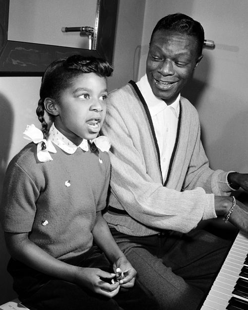 Nat King Cole Smoking | Singer Nat King Cole with his daughter Natalie Cole c.1956