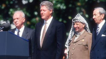 World leaders Yitzhak Rabin, Bill Clinton, Yasser Arafat and Warren Christopher pose together at the White House after signing the Middle East peace accord. The 1993 accord allowed Palestinian self-rule in Israeli-occupied Gaza and the West Bank regio