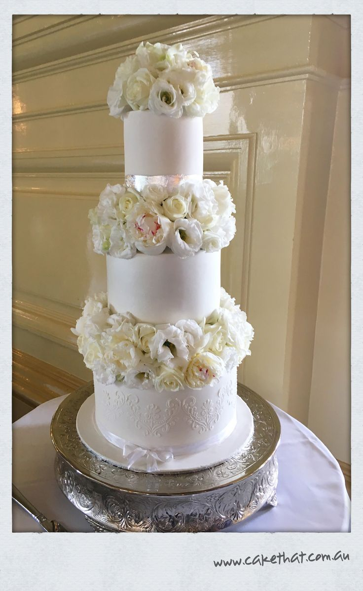 Three tier fresh flower stack cake. Florals by Bliss Floral. Pearl finish mid tier. Stencil finish. Silver leaf