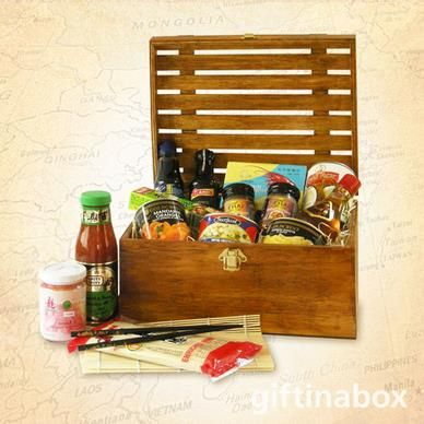 THE ORIENT  For pure indulgence and delectable pleasure, spoil yourself with the taste of the exotic in this unique gourmet gift hamper. All treats are lovingly presented in an exquisite wooden crate with hinged lid and filled with wood wool.   Water chestnuts Mandarin oranges Bamboo shoots Chinese stir fry noodles Chinese Green Tea Teriyaki sauce Sesame oil Soy sauce Coconut milk Prawn crackers Sweet and sour sauce Massaman curry paste Wasabi tube Pickled ginger Pair of chopsticks Sushi mat