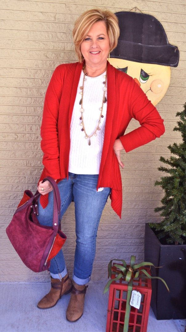 I like the orange sweater, jeans, necklace & top - Not purse.