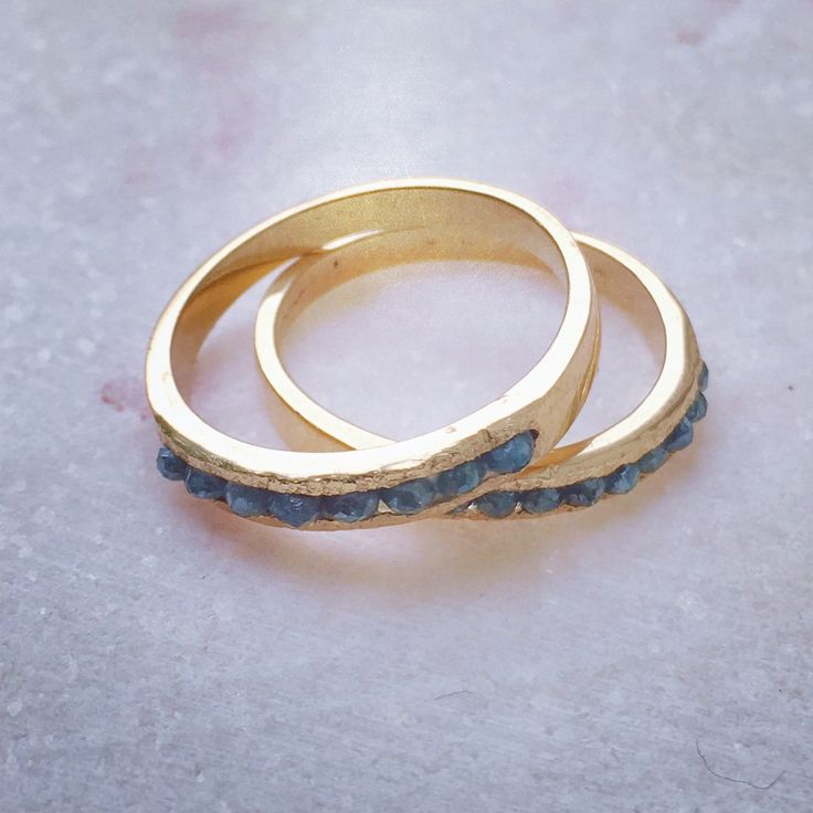 Blue diamonds and 18 carat gold rings. Elegant with an edge.