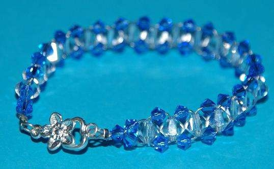 Elegant yet also affordable!  Swarovski Crystal Bracelet Blue and Clear with Flower by Tazzmck