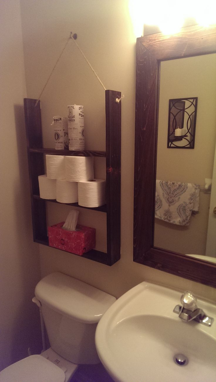 Reclaimed wood bathroom storage and mirror frame