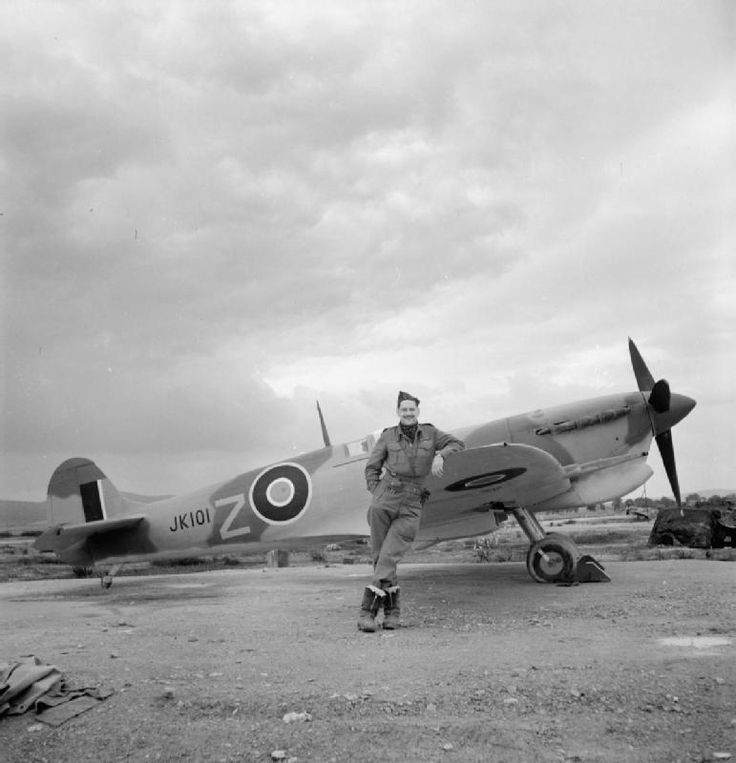 Squadron Leader M. Rook, Commanding Officer of No. 43 Squadron RAF, noted as the tallest pilot in the Royal Air Force at the time, standing next to his new Spitfire