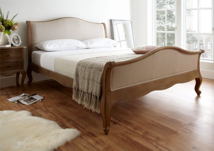 The Amelia High foot end bed combines all the beauty and elegance of it's lower foot ended sister.  Perfectly formed and carefully crafted, the natural beauty of this oak frame is combined with a stylish linen look fabric to create a bed that is sure to be a spectacular centre piece in any bedroom.  The bed comes complete with a traditional wooden slatted base.  Create a warm and opulent look in your bedroom with this classic sleigh design which will work well in either a period house or…