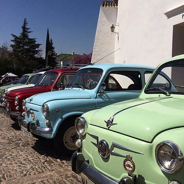 Vintage Seat 600 cars in Ronda  Image copyright: Andrew Forbes www.andrewforbes.com #Luxury #Travel #Hotels #Restaurants #Culture #Lifestyle #luxurytravelpursuits #luxestyletravel