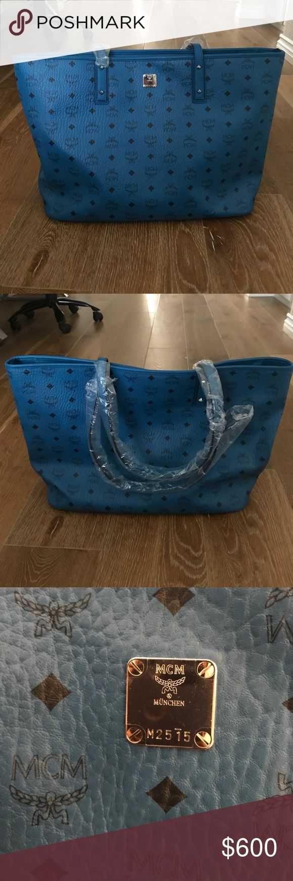NWOT MCM Bag NWOT Blue monogram MCM bag. Dust bag included. Can be used for every day use or for traveling. Measurements are shown in pictures. MCM Bags Totes