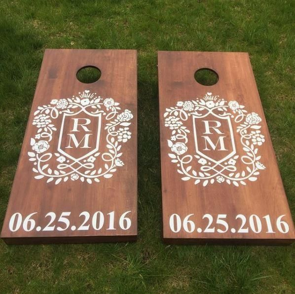Add a monogrammed custom crest with the date to your cornhole boards for weddings or any event!
