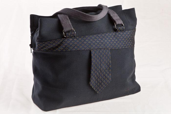 "A tote bag ""Tuuri"" by Finnish fashionbrand Globe Hope. The bag is decorated with a men's necktie. GH makes bags, accessories and clothes from recycled materials for example a very durable army surplus materials."