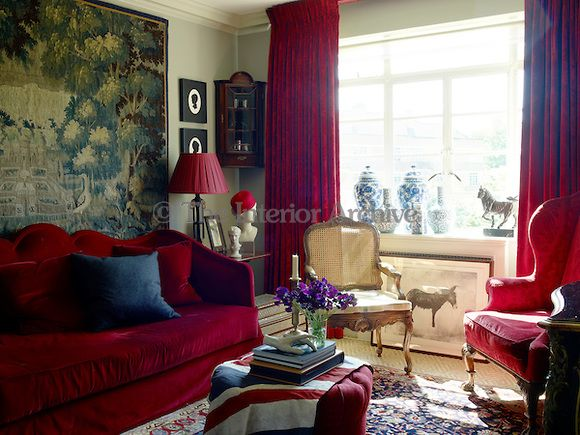 Furniture In The Living Room Is Upholstered Red Velvet And Damask With Curtains To Match