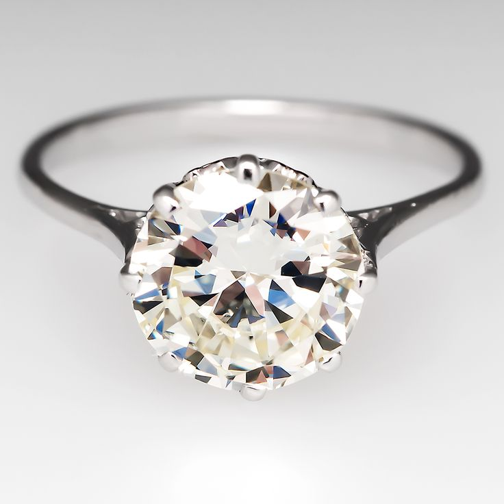 2 CARAT DIAMOND CROWN SOLITAIRE ANTIQUE ENGAGEMENT RING This gorgeous 1930's crown antique engagement ring is crafted of solid 18k white gold. The ring features a glorious 2.28 carat transitional cut diamond set into a highly decorated 8 prong crown head.