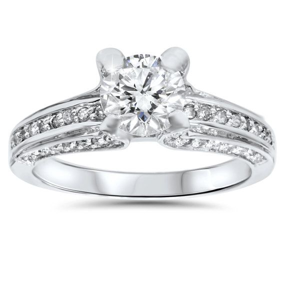 Product Details Item # ENG1807E.5 Width: 4 mm Metal: 14k White Gold Diamond Cut: Round, Brilliant Diamond Color: G/H Diamond Clarity: I1 Diamond Carat: