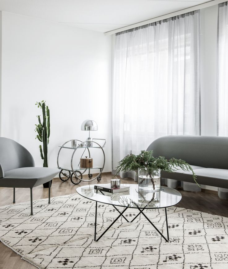 Oslo sofa and chair by Muuto and Pedrera coffee table by Gubi.