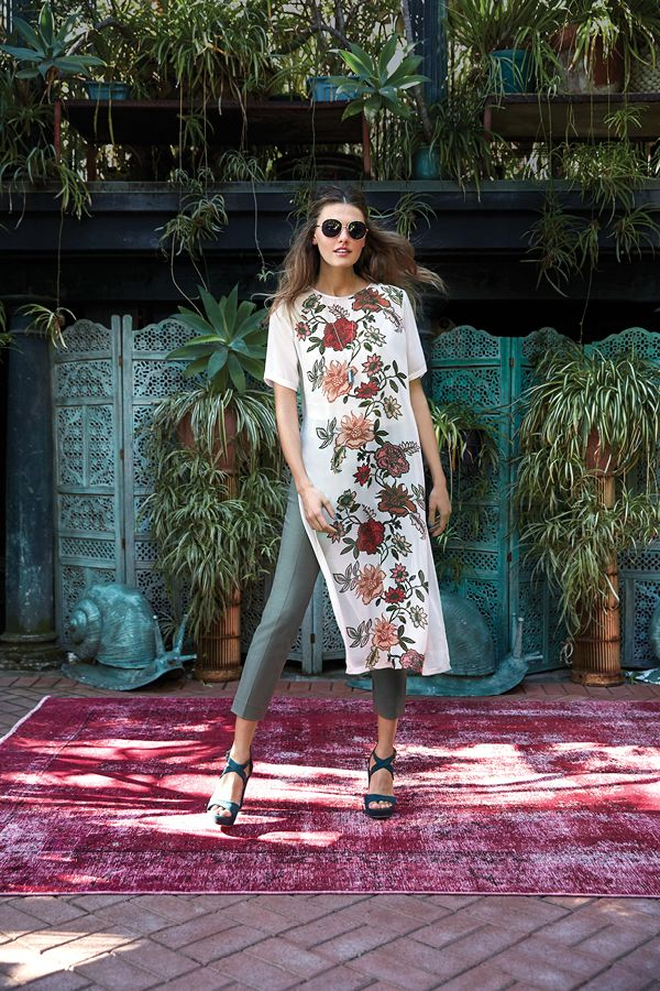 Push your fashion limits this spring and layer a Vince Camuto tunic over cropped skinny pants. A boho print and muted earth tones look hippie-chic and positively carefree.