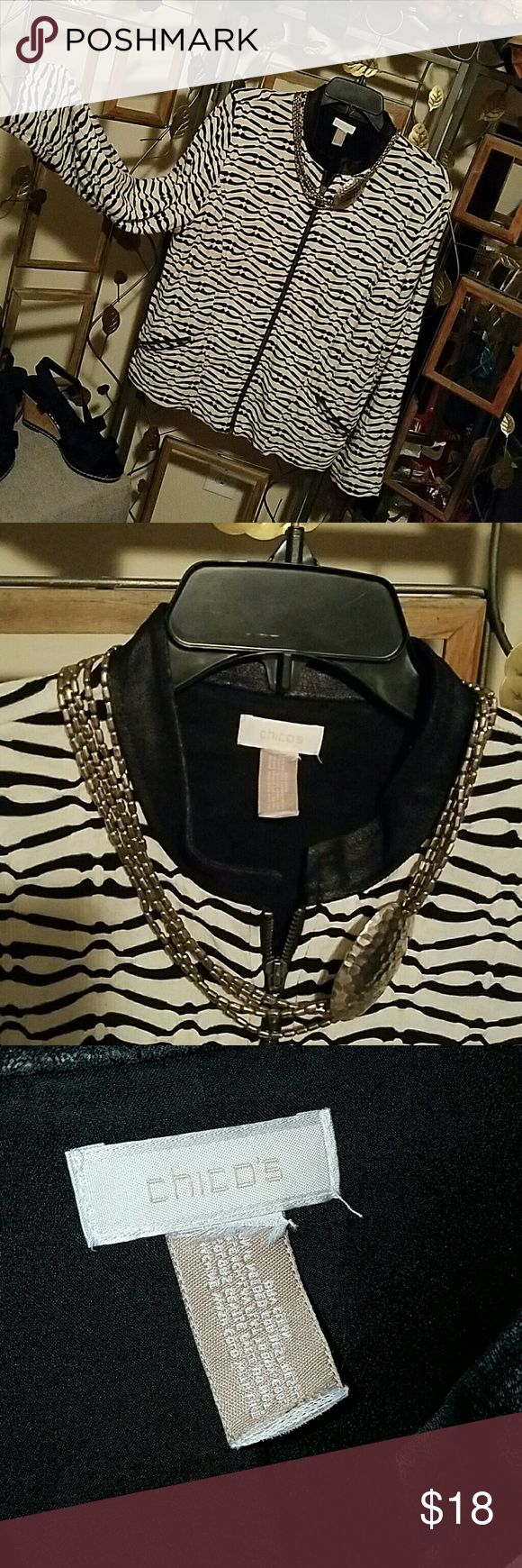 Chico's size 3 zip up zebra striped jacket. Jazzy, Chico's zebra striped, zip up jacket with faux leather trimmed collar.  Side zip pockets.  Fully lined.  Minimum wear, size tags is no longer attached but it is a size  3 in Chico's sizing or a 14-16 in regular size charts.  In great condition. Chico's Jackets & Coats