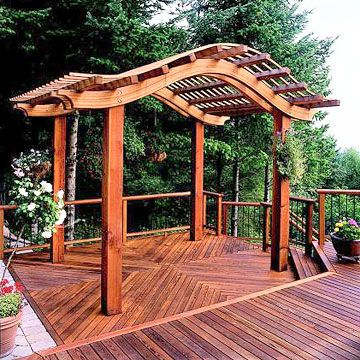Decorate Your Deck_Just like it can enhance a patio, the right arbor can add drama to your deck. Keep the style and scale of your structure consistent with the rest of your deck for an extra-special, beautiful area.
