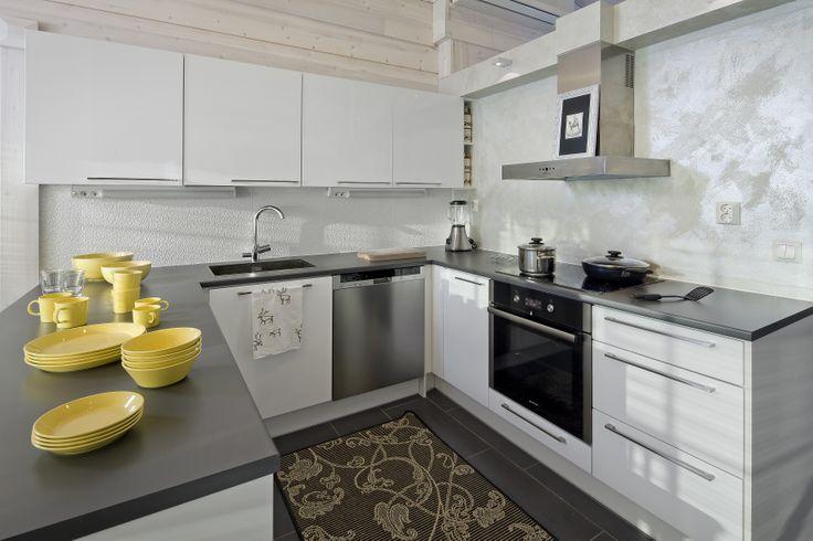 White & grey kitchen loves yellow. Honka log homes.