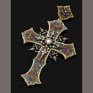 Of Byzantine style, the polychrome cloisonné enamel cross inset with rose-cut diamonds, the central silver plaque mounted with old brilliant-cut and rose-cut diamonds, to the similarly-set surmount, possibly Italian, mounted in silver and gold, gross weight 33.3 grams, length 9.5cm
