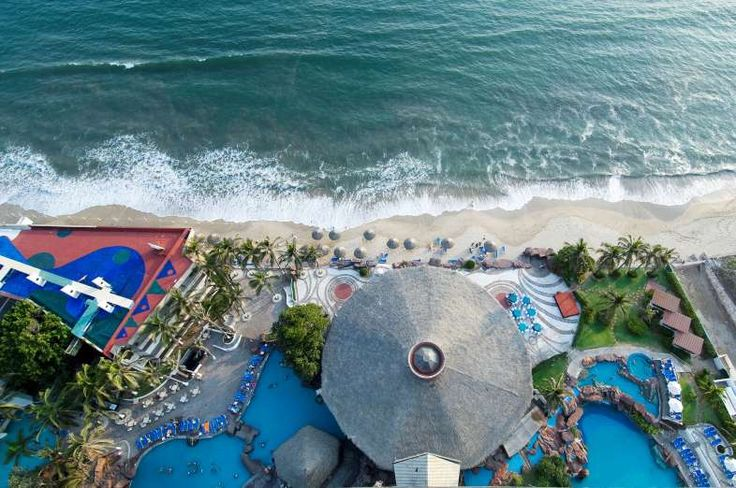 Aerial view of El Moro hotel with swimming pools, palapas, and beachfront, Mazatlan, Sinaloa, Mexico... - Mark D Callanan/Photolibrary RM/Getty Images