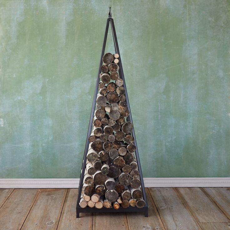 "A practical statement piece for the hearth or porch, this contemporary log holder is hand-forged from durable iron.- A terrain exclusive- Iron- Indoor or outdoor use- Will rust if used outdoors- USA72""H, 24""W, 24""D"