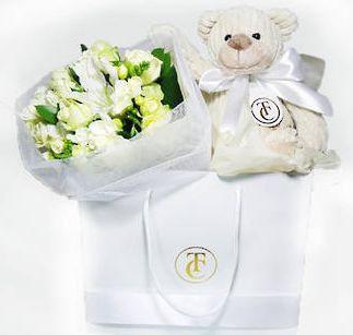 Here's Total Cuteness for mum from Tomuri & Co. A pleasant gift of seasonal white and green flowers accompanied by a plush Teddy Bear to remind her of you! Comes in a gift bag too.