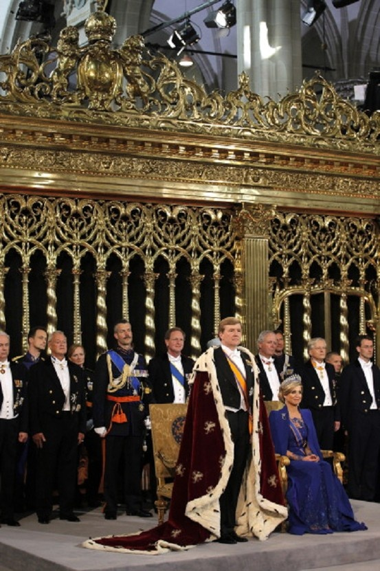 King Willem Alexander and Queen Maxima of the Netherlands are joined by members of the royal household during their inauguration ceremony at New Church on 30 April 2013 in Amsterdam