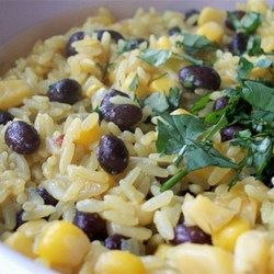 Black Beans, Corn, and Yellow Rice Allrecipes.com  (alter by adding a can of diced tomatoes w/ green chilies, and fresh cilantro instead of parsley)