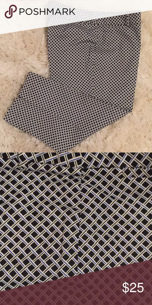 Navy Blue and White Capris Pants Capris pants.  Color:  Blue and white.  Diamond print.  Slit on each leg.  Belt loops.  Zipper front.  Size:  12.  Body Material:  98% Cotton.  2% Spandex Rafaella Pants Capris