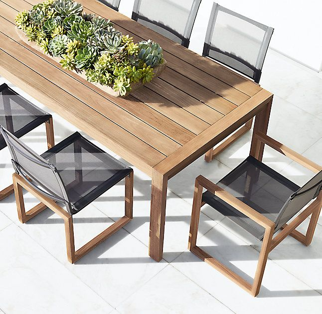 RH's Aegean Teak Side Chair:Influenced by the low, linear silhouettes of seaside architecture, our contemporary collection is designed by a family-owned company in Australia known for its meticulous craftsmanship. Its teak construction and simple geometry enable it to weather the elements in enduring style.
