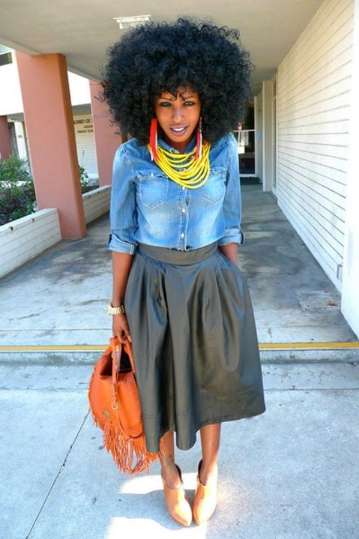 Outfit Idea #3. Rock a leather midi-skirt, denim shirt and booties. Wearing a heavyweight bottom and shoes that fully cover your feet balance out a thin top.  Just like the idea...