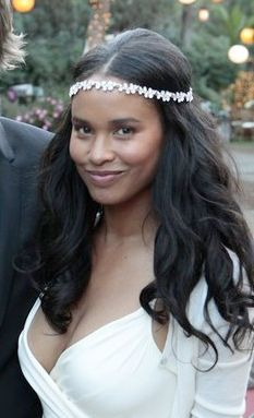 "joy bryant as claire (receptionist at SIP) - ""a young african-american woman with large silver earrings and long straightened hair. she has a bohemian look about her, the sort of woman i could be friendly with."" - fifty shades of grey"
